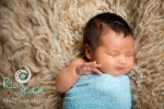 newborn-on-a-flokati-rug-pose-newborn-wrapped-poses