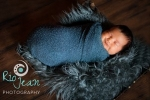kent-area-photography-newborn-photography-newborn-wrapped-pose-flokati-rug-newborn-in-a-basket