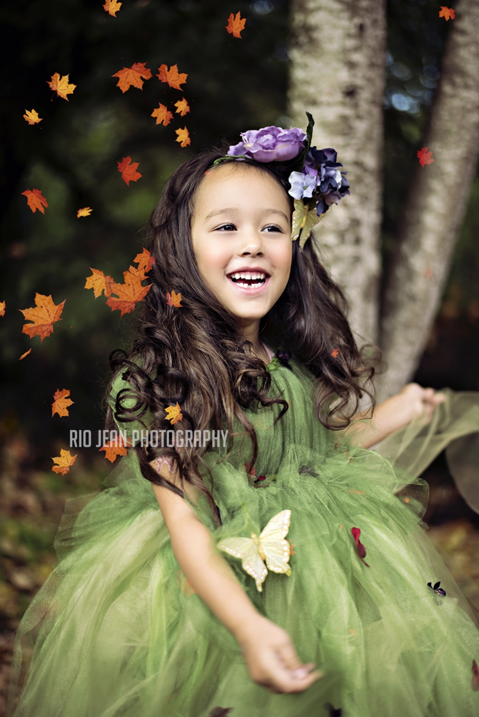 Little -girl-in-green-tulle-dress-throwing-leaves