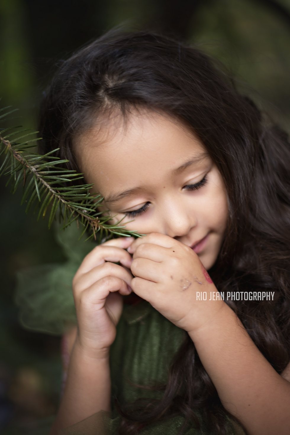 little-girl-holding-a-tree--branch