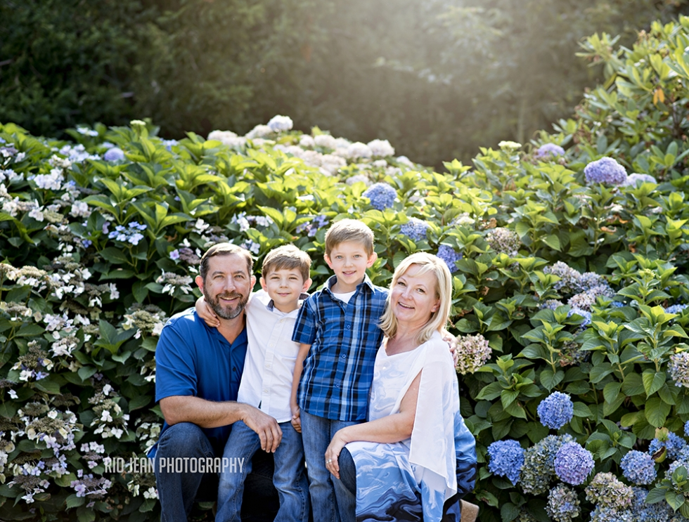 Family sitting by Hydrangea Bushes